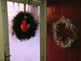 Christmas Wreaths Hanging on the Storm and Front Doors of a House