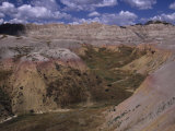 Colorful Hills under a Cloudy Sky in the Western Badlands