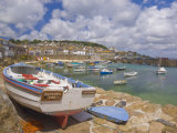 Small Boat on Quay and Small Boats in Enclosed Harbour at Mousehole  Cornwall  England