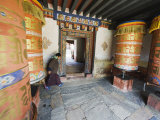 Woman Spinning a Prayer Wheel  Jambay Lhakhang  Built 659 by Tibetan King Songtsen Gampo  Bhutan