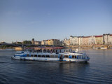 Sightseeing Boat on Vltava River with East Bank and Jiraskuv Bridge  Prague  Czech Republic  Europe