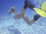 Woman Snorkeling in the Maldives  Indian Ocean  Asia
