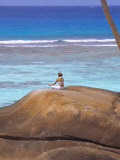 Young Woman Meditating on Rock  Seychelles  Indian Ocean  Africa