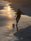 Young Man Playing Football at Sandbeach in Twilight  Santa Maria  Sal  Cape Verde  Africa