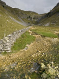 Entrance to Malham Cove with Threatening Clouds Overhead  Yorkshire  England  United Kingdom