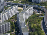 Monorail Train Weaving Through Housing Development on Sakishima Island  Osaka  Japan