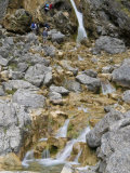 Climbing Up the Waterfalls at Goredale Scar at Malham Cove  Yorkshire Dales National Park  England
