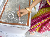 Woman Painting Doorstep with Rice Flour Paste  Making Rangoli Diwali Festival Decorations  India