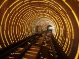 Empty Tourist Subway Car Runs Through Illuminated Tunnel in Shanghai  China