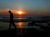 Buddhist Monk Walks Along the Beach During Sunset in Khoa Lak  Thailand