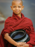Young Myanmar Buddhist Monk Smiles Broadly as He Waits for Donations Early on a Yangon Street