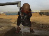 Refugee Washes His Face in a Refugee Camp in the Outskirts of Kabul  Afghanistan