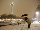 Photographer Anthony Evora Uses an Umbrella to Keep Falling Snow Off of His Camera  in Seattle