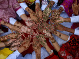 Pakistani Girls Display their Hands Decorated with Mehndi or Henna