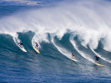 Surfers Ride a Wave at Waimea Beach on the North Shore of Oahu  Hawaii