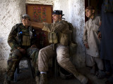 US Marine LCpl Mathew Gorzkiewicz Tries Out an Afghan Boy's Sling During a Patrol in Afghanistan