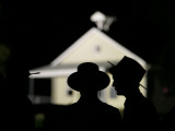 Amish Men in Front of the Schoolhouse Where a Gunman Shot Several Students and Himself