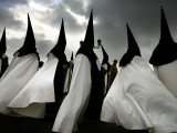 Penitents of La Esperanza De Triana Brotherhood During Holy Week in Seville  Spain