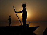 Boatman Prepares to Anchor His Boat  after the Day's Work in River Ganges  in Allahabad  India