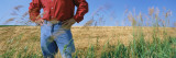 Mid Section View of a Farmer in an Oat Field  Saunders County  Nebraska  USA