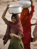 Woman Smiles after Collecting Drinking Water  on the Outskirts of Islamabad  Pakistan