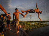 Youths Play in a Lagoon Near the Eastern Beni State Capital of Trinidad  Bolivia