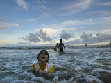 Child as She Plays in the Waves at a Beach in Port Blair  India