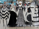 "Models on Stilts Present ""High Fashion"" on the Famous ""Jungfernstieg"" Boulevard in Hamburg  Germany"