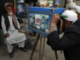 Afghan Street Photographer Takes a Portrait of a Customer with a Wooden Made Camera