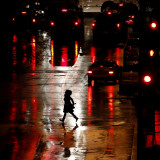 Pedestrian in Rain-Soaked Street in Country Club Plaza Shopping District of Kansas City  Missouri