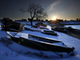 Sun Rises in Mackerel Cove on Bailey Island Where Fishermen's Skiffs Wait Out the Winter  in Maine