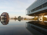 Image of the Clinton Library Building and an Old Bridge Reflected in a Pool
