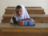Girl Sits Alone in Her Class Room During a Break in Aftabachi School in Eastern Afghanistan