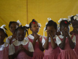 School Girls Pray before Class at the Sacred Heart of Turgeau School in Port-Au-Prince
