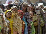 Pakistani Women Queue Up to Get Subsidized Sacks of Flour for the Holy Month of Ramadan