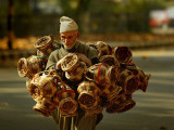 Kashmiri Carries &#39;Kangris&#39; or Firepots to Sell in a Market in Srinagar  India