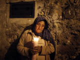 Elderly Woman Holds a Candle as She Takes Part in a Procession During Holy Week in Taxco  Mexico