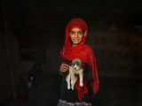 Girl Holds a Puppy as the Sun Sets over Kabul's Impoverished Teppe Maranjan Neighborhood Papier Photo