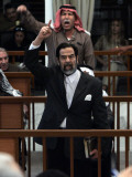 Former Iraqi President Saddam Hussein Berates the Court During their Trial in Baghdad