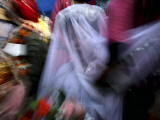 Bride Sits Next to Groom During a Mass Marriage Ceremony for About 50 Couples in Amritsar  India