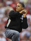 President Obama Winds Up to Throw Out the First Pitch During the MLB All-Star Baseball Game in St