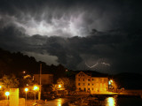 Lightning Illuminates the Sky over Prvic Luka During a Summer Storm on the Island of Prvic  Croatia