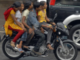 Boy Rides a Motorbike with Four Girls  as it Drizzles in Hyderabad  India