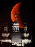 Moon is Seen Rising in the Sky Above the Domes of the Smolny Cathedral in StPetersburg  Russia