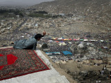 Afghan Youth Sits on a Rooftop During the Celebration of Nowruz