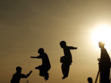 Youths Play on a Trampoline at Sunset in the Neighborhood of Islamabad  Pakistan