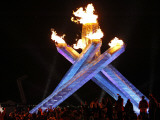 Spectators Surround the Olympic Flame at the Vancouver 2010 Olympics
