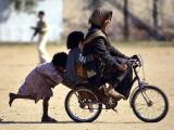 Girls Play on a Bike in Jammu  India