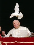 Pope John Paul II Looks at a White Dove After the Angelus Prayer in St Peter's Square  at Vatican