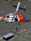Coast Guard Rescues One from Roof Top of Home  Floodwaters from Hurricane Katrina Cover the Streets